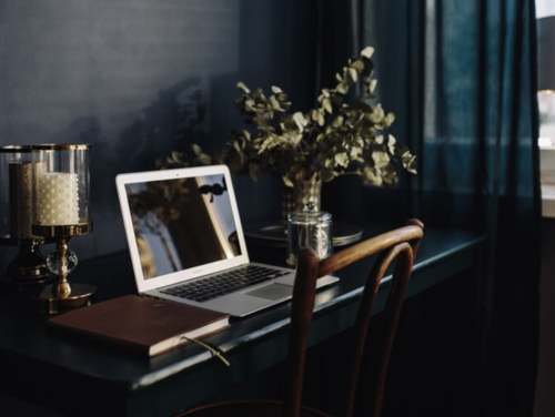 Rterior-Studio_West-Hollywood-and-LA_Moody-Inspired-Interiors_What-is-it-Really-Like-to-Work-with-Rterior-Studio_Laptop-on-Desk-in-Dark-Moody-Home-Office.png