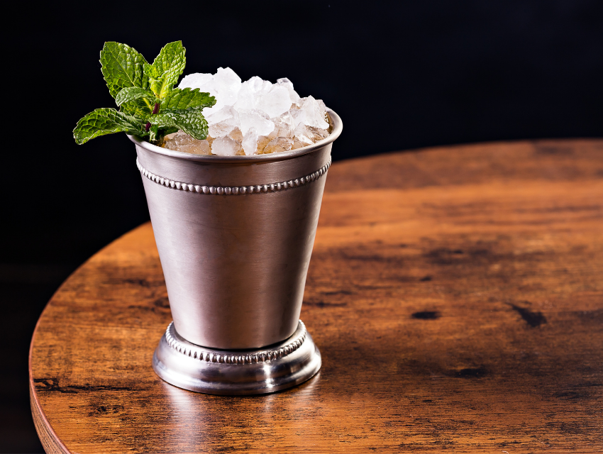 rterior studio west hollywood mint julep cocktails in metal tumbler on a wood table